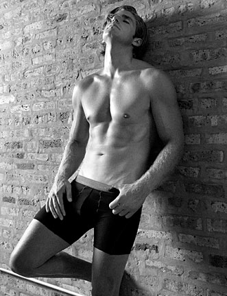 Male model against brick wall